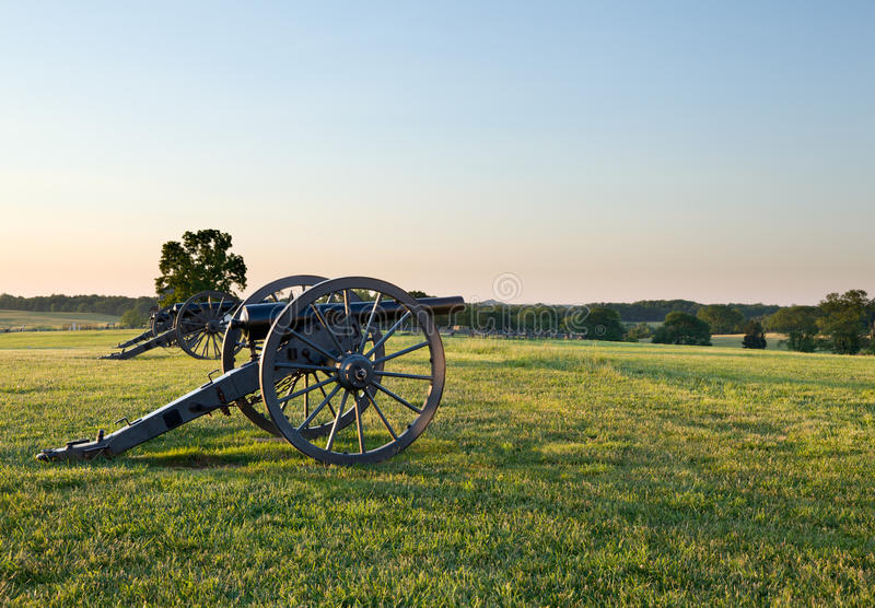 Cannons at Manassas Battlefield. Sunset view of the old cannons in a line at Manassas Civil War battlefield where the Bull Run battle was fought. 2011 is the stock photography