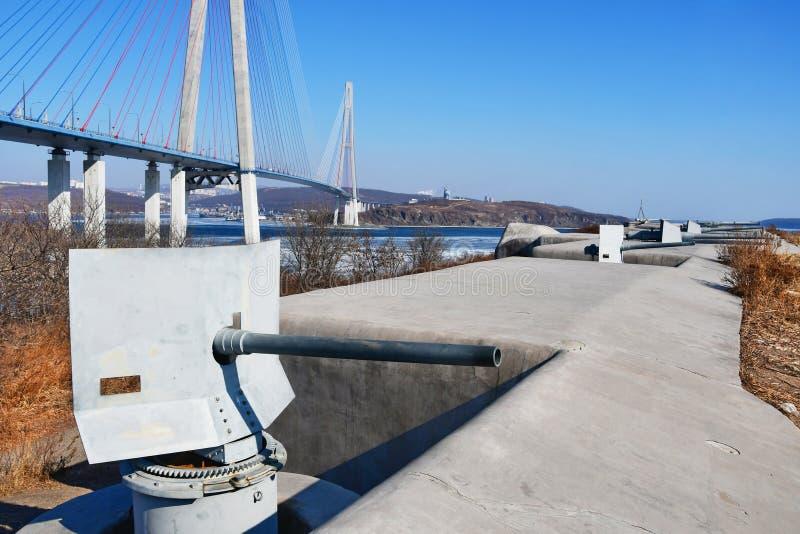 Cannons of the Novosiltsevskaya coastal battery of the Vladivostok fortress of beginning of 20 century on Russkiy island in Vladiv stock photo