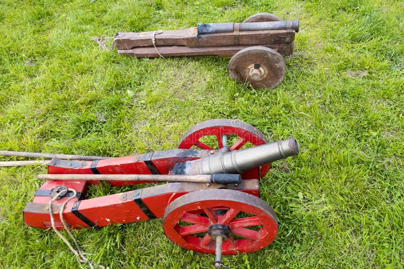 Cannons. Two ancient cannons are located on the green grass in the summer stock images