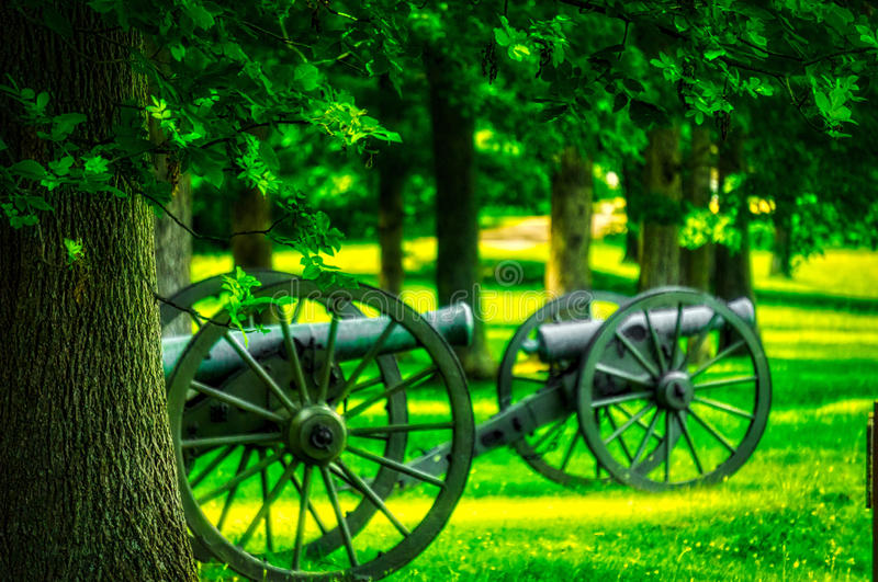 Two Cannons on a Battlefield. Cannons Waiting in the Morning Fog at a local park in Fredericksburg, VA stock photo