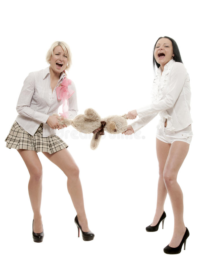 Cannot divide. Two girs divide between themselves toy bear stock images