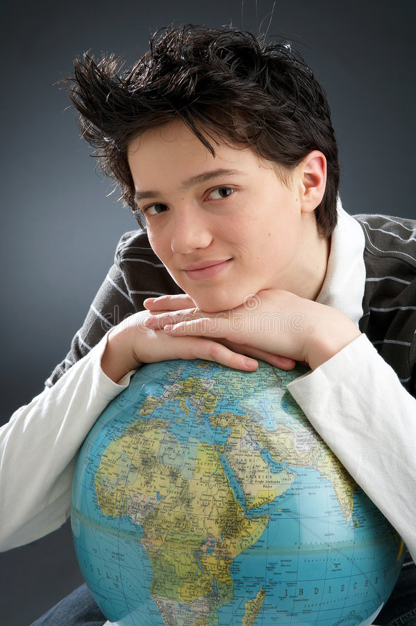 Canny. Young man on dark Background with globe royalty free stock image