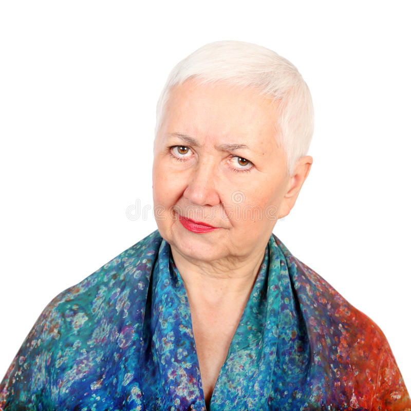 Canny Senior Lady. Canny looking senior woman portrait, on white isolated background royalty free stock image