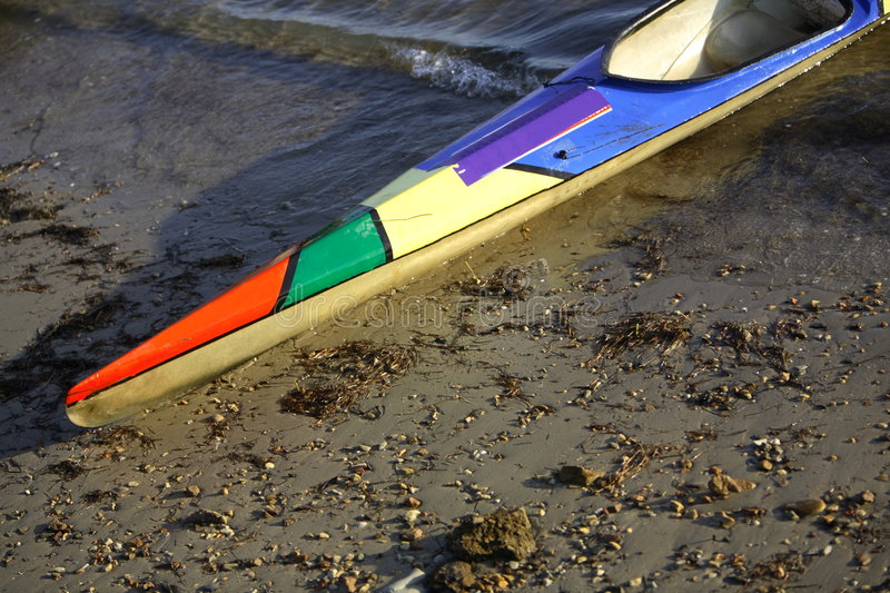 Canoe. Racing canoe at the side of a lake royalty free stock image