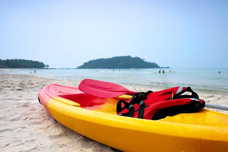 Canoe. On the beautiful beach stock photography