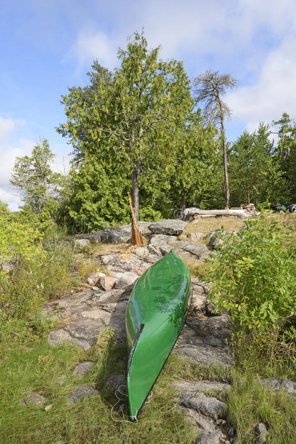 Canoe in Camp in the Shore stock images