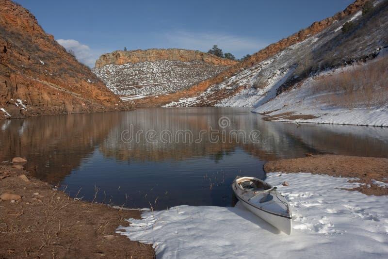 Canoe on Colorado mountain lake stock photography