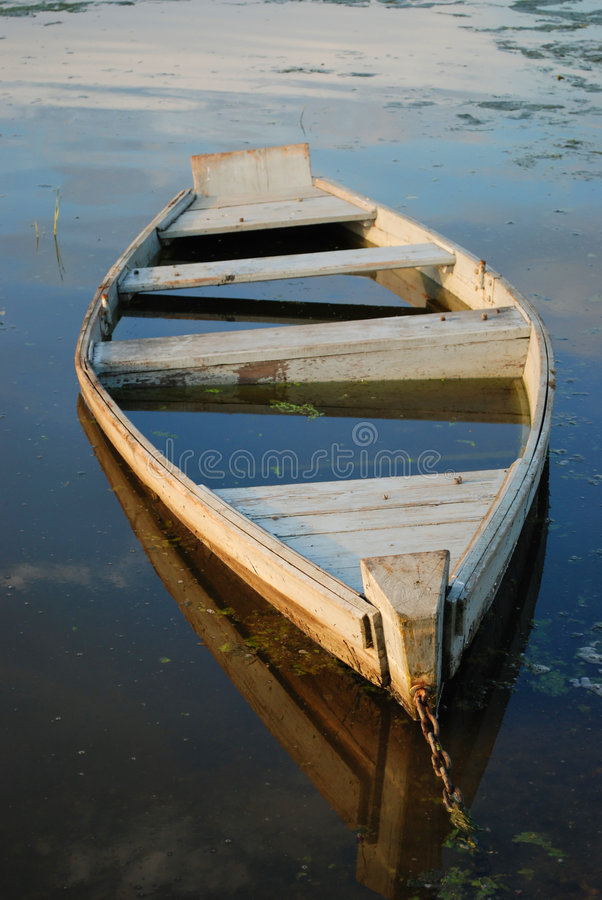 Canoe filled with water stock images