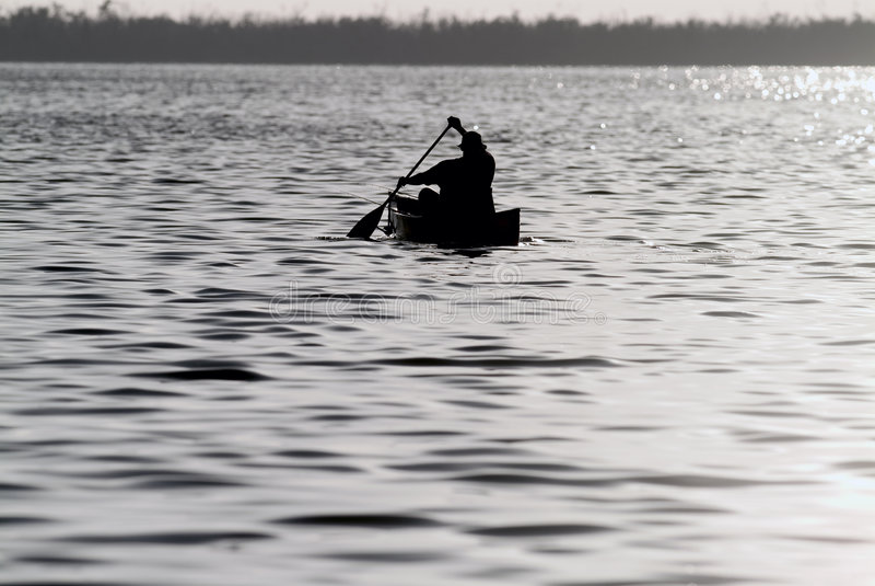Canoe Fishing stock image