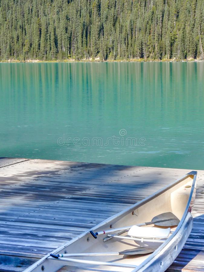 Lake Louise View. A canoe on a jetty at Lake Louise, Canada stock photography