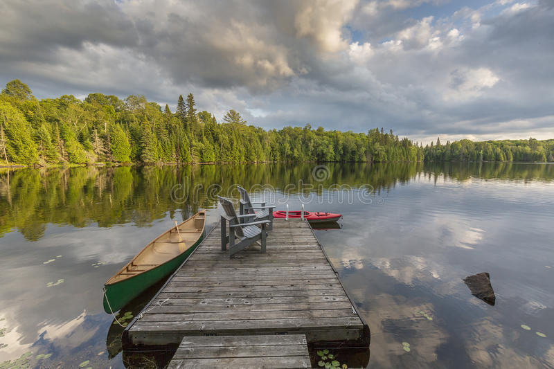 Download Canoe And Kayak Tied To A Dock On A Lake In Ontario Canada Stock Photo - Image of approaches, scenic: 98484548