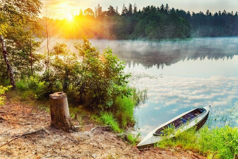 Canoe on a lake. At foggy morning royalty free stock photos