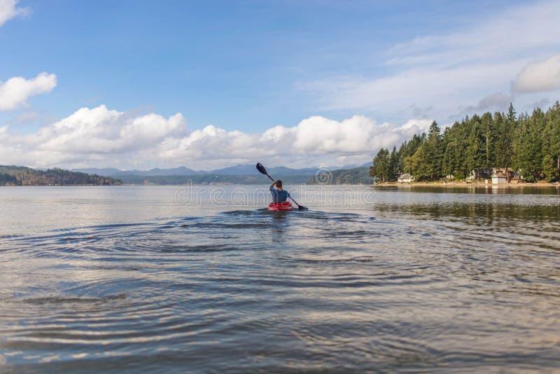 Canoe on lake stock photography