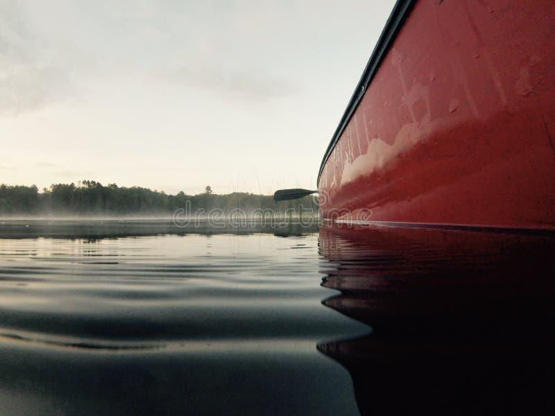 Canoe on lake stock images