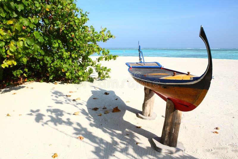 Canoe on Maldives beach royalty free stock image