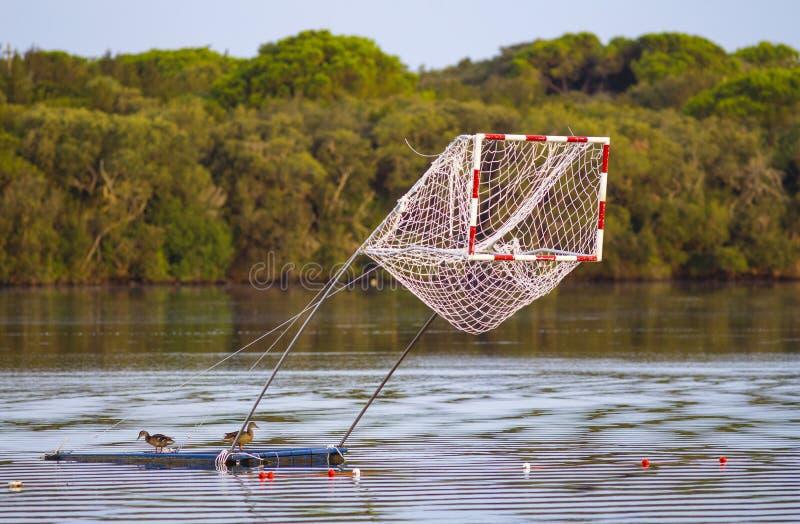 Canoe polo. Field in a beautiful italian lake royalty free stock image