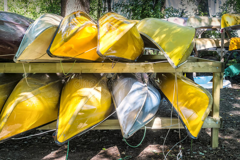 Canoe for rent. Bunch of colorful canoes ready for rent royalty free stock photos