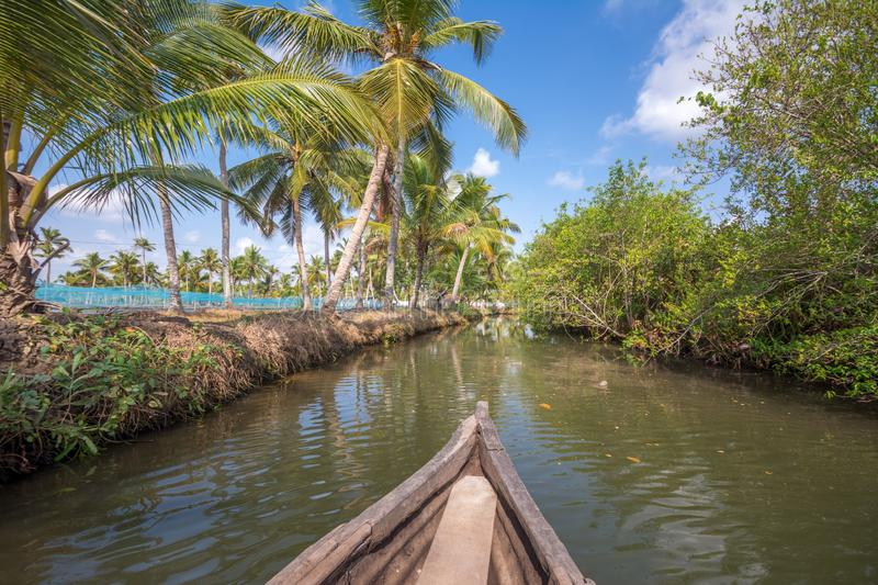 Canoe ride through backwater canals in Munroe Island stock image