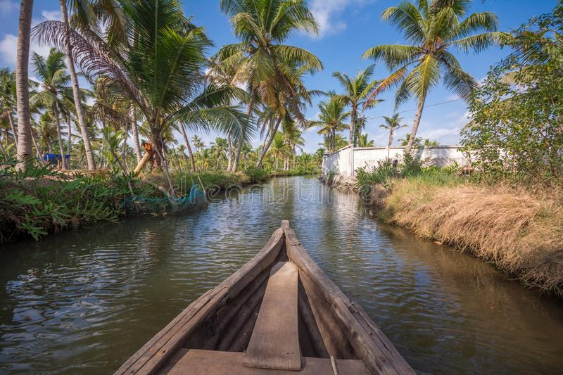 Canoe ride through backwater canals in Munroe Island stock photography