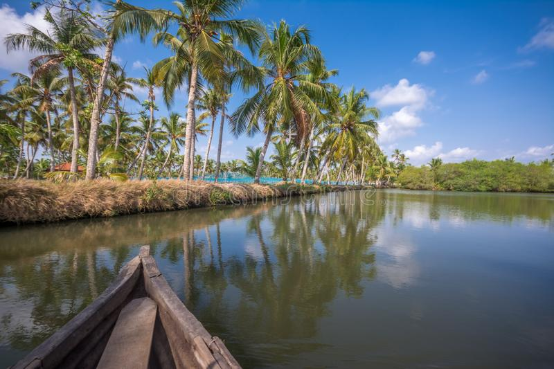 Canoe ride through backwater canals in Munroe Island stock images