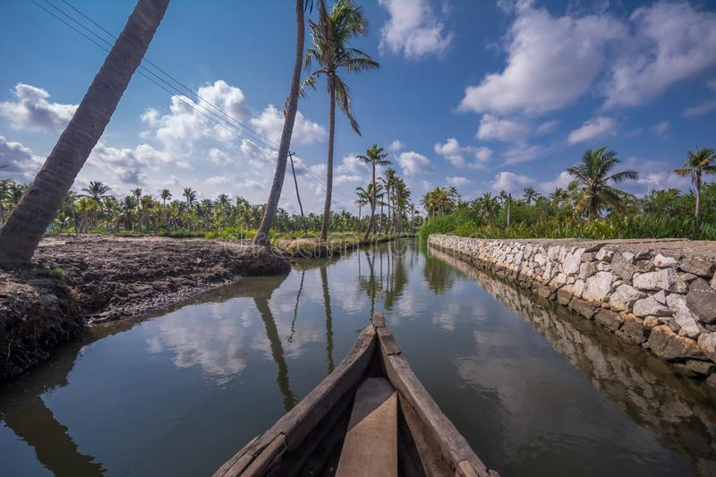 Canoe ride through backwater canals in Munroe Island royalty free stock image