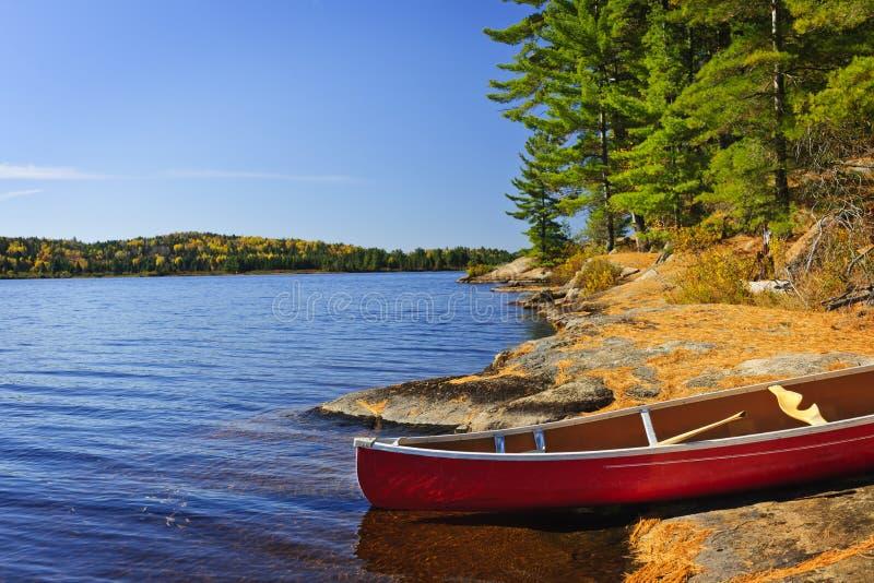 Canoe on shore stock images