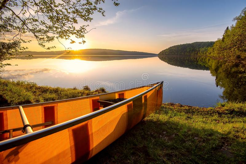 Canoe on the shore of the Boundary Waters in northern Minnesota. At sunrise stock photos
