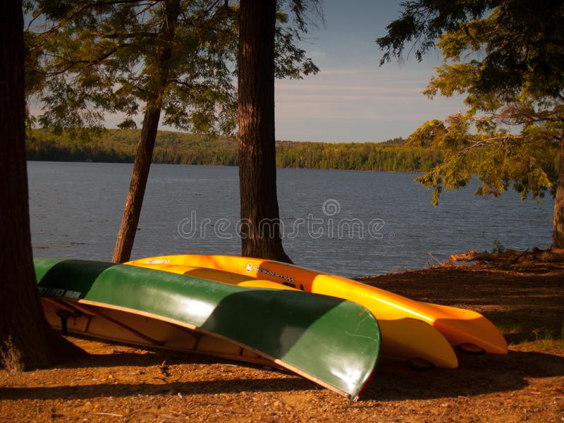Canoe on the shore of a lake stock photography