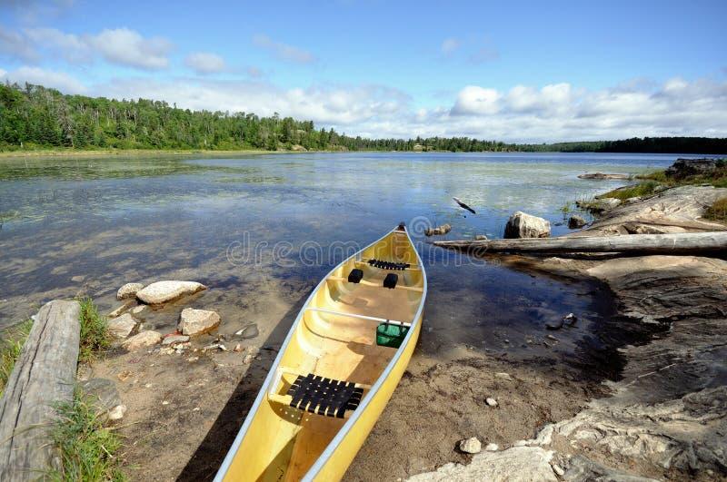 Canoe on the Shore of Wilderness Lake. Kevlar Canoe on the Shore of Wilderness Lake royalty free stock image