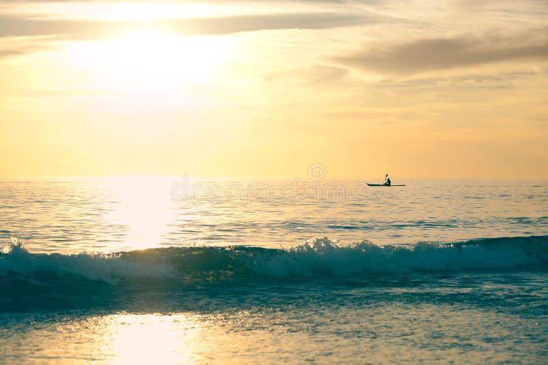 Canoe Into The Sunset Stock Photos