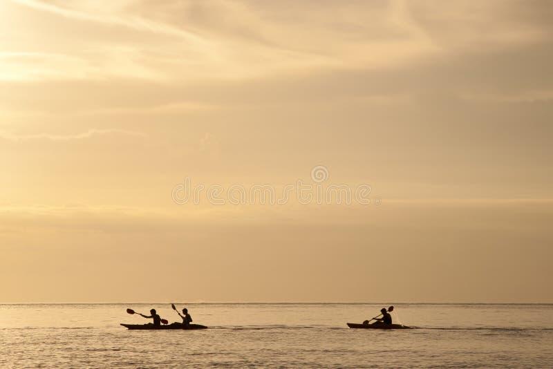 Canoe Surfing Sunset royalty free stock photo