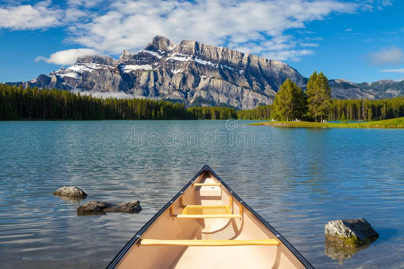 A canoe on the water at Two Jacks Lake in Banff National Park stock images