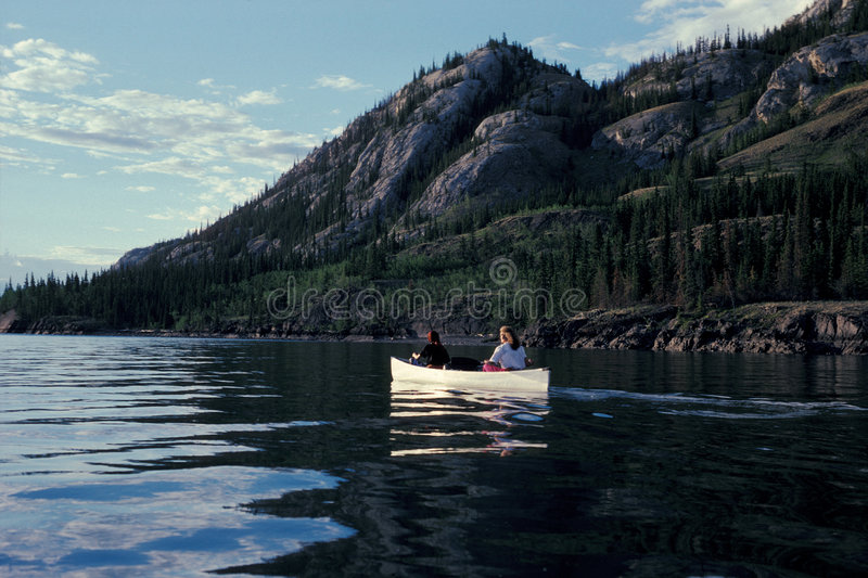 Canoeing canada. Canoeing on Lake Laberge, Yukon, Canada royalty free stock photo