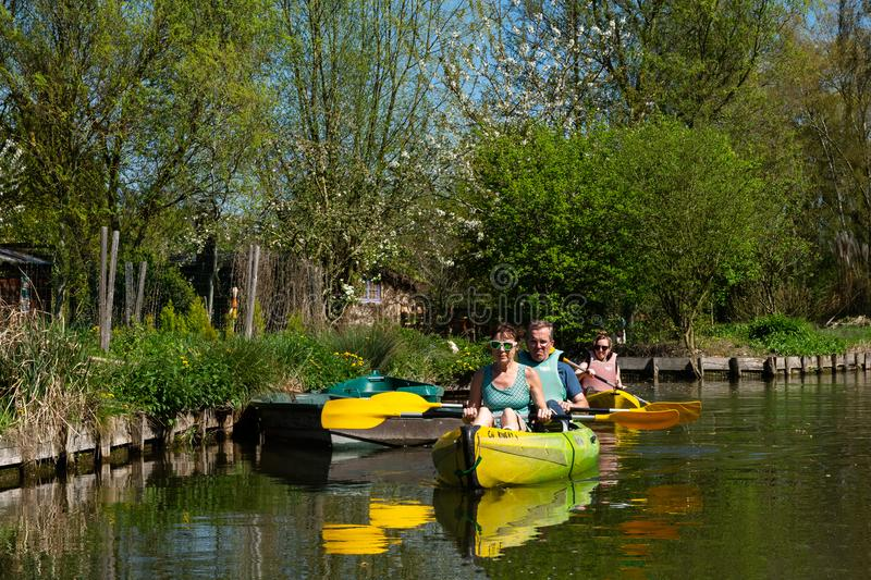 """Canoeing on the hortillonnages of Amiens in Picardie. The hortillonages """"floating gardens"""" are emblematic of Amiens. They are interlaced with 65km of royalty free stock photo"""
