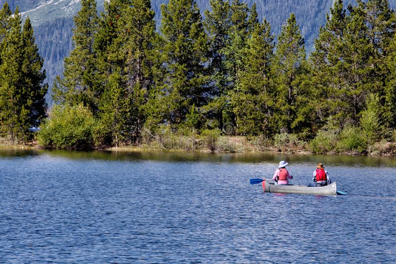 Canoeing on Jackson Lake in Wyoming. stock photos