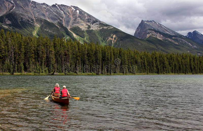 Download Canoeing on Lake stock image. Image of recreation, trees - 20590469