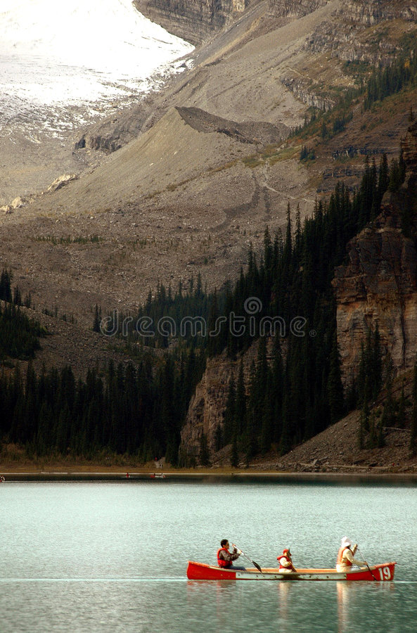 Download Canoeing On Lake Louise stock photo. Image of pine, time - 1538046