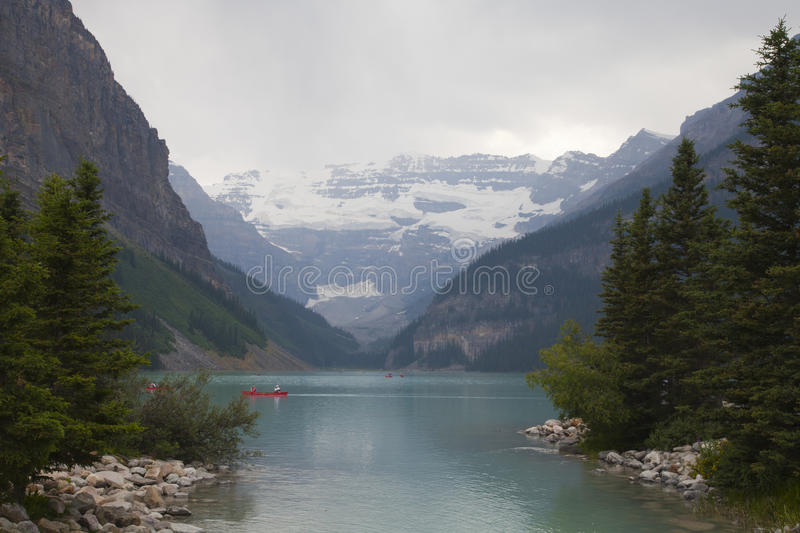 Canoeing on Lake Louise, Alberta. Canoeing on the beautiful emerald colored water of Lake Louise in Banff national park, Alberta, Canada royalty free stock photo