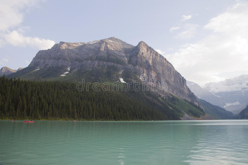 Canoeing on Lake Louise, Alberta. Canoeing on the beautiful emerald colored water of Lake Louise in Banff national park, Alberta, Canada royalty free stock photos