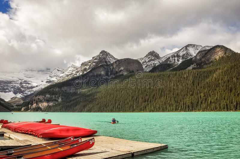 Canoeing at Lake Louise, Alberta, Canada. Lake Louise, one of the most beautiful alpine lakes in the Canadian Rockies, famous for the green-blue color of the stock images
