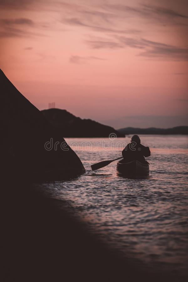 Canoeing on a late night stock image