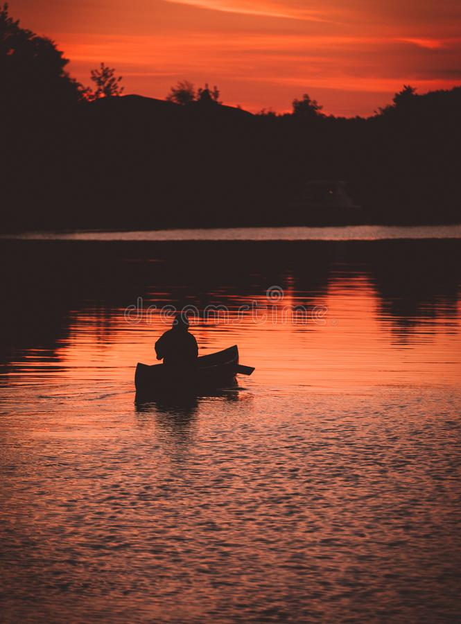 Canoeing on a late night stock photo