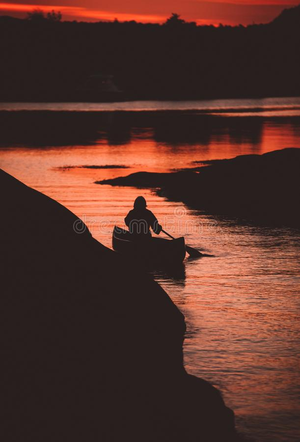 Canoeing on a late night royalty free stock photos