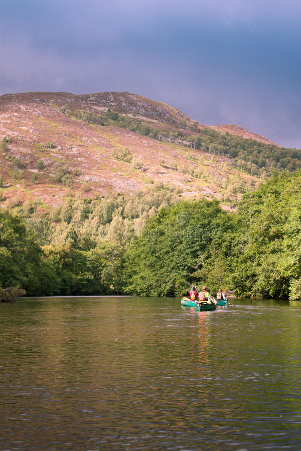 Canoeing on a river royalty free stock photography
