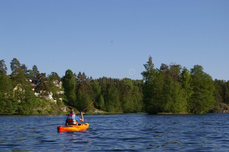 Canoeist en el lago fotografía de archivo libre de regalías