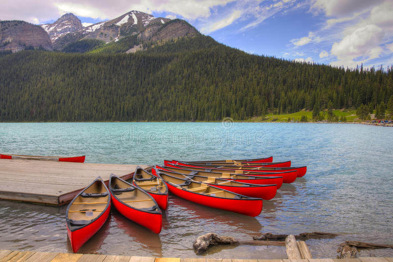Canoes on Beutiful Lake Louise. HDR Canoes on Lake Louise, Banff National Park, Alberta, Canada royalty free stock images