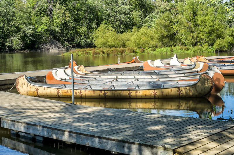 Canoes. Bunch of colorful canoes ready for rent stock photos
