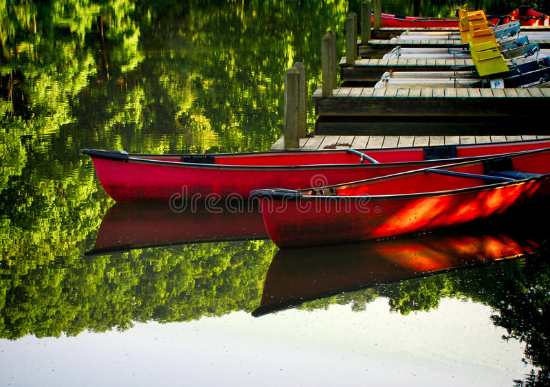 Canoes at dock 3 stock photo