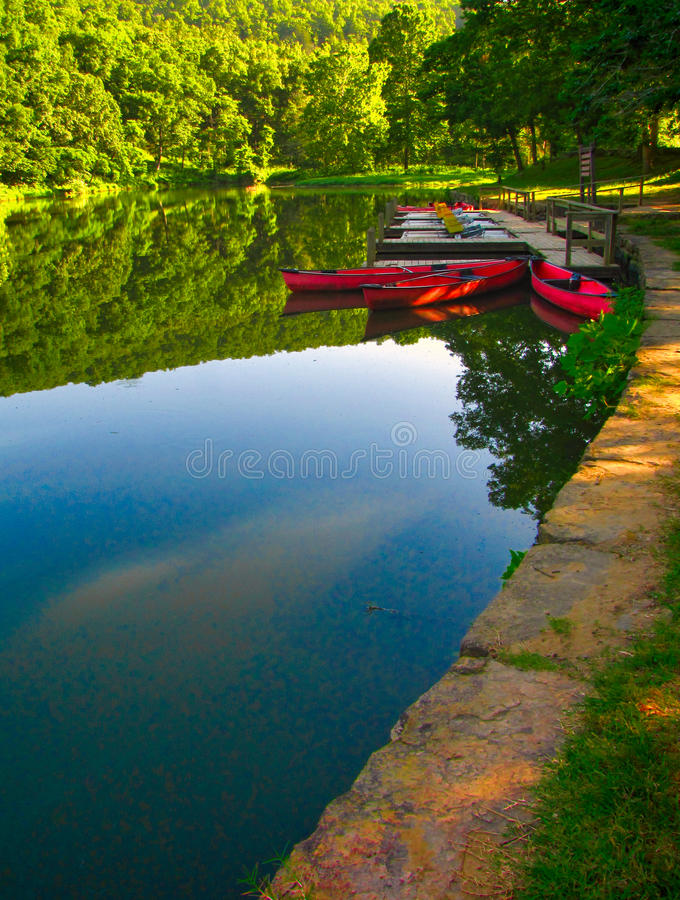 Canoes at dock 4 royalty free stock image