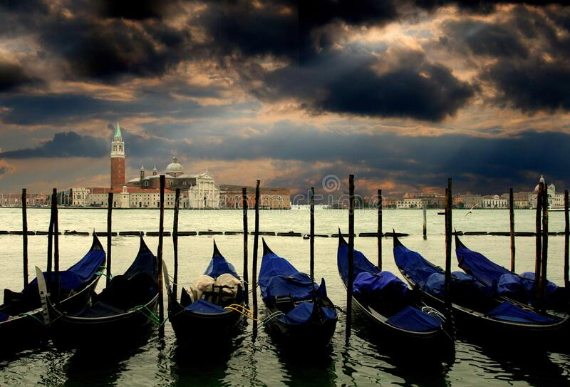 Canoes Docked in Water Near Concrete Structures stock image